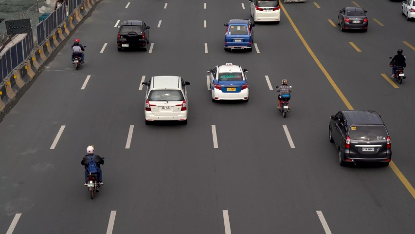 Vehicles drive down a road separated by lanes | Shutterstock HD Video #1046579368