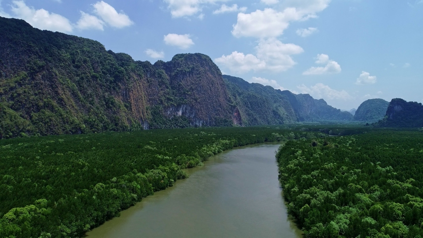 Aerial view drone shot of beautiful natural scenery river in mangrove forest and high mountains in phang nga province Thailand | Shutterstock HD Video #1046634748