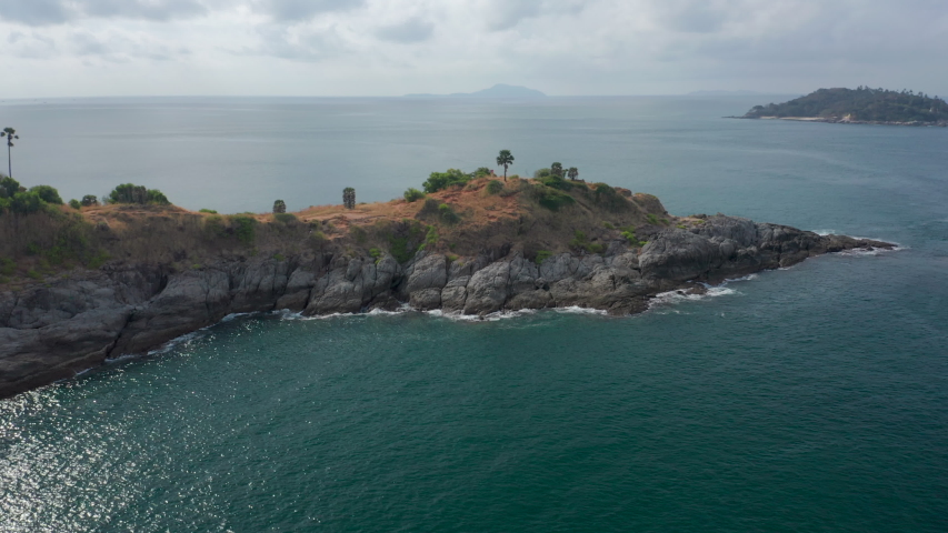 Aerial view of the Promthep Cape on the south of Phuket island in Thailand. Orbiting around southernmost tip of Phuket island. | Shutterstock HD Video #1046736118
