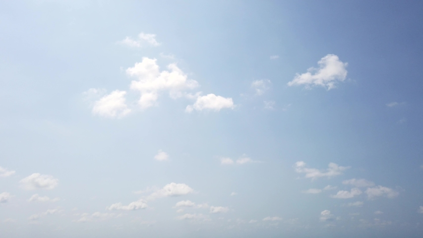Young lady in red swim suit, long white dress and sun glasses runs on beach on background of blue sky with clouds. View from below. Positive. Dress fluttering on wind. Honeymoon. Super slow motion.    Shutterstock HD Video #1046805628