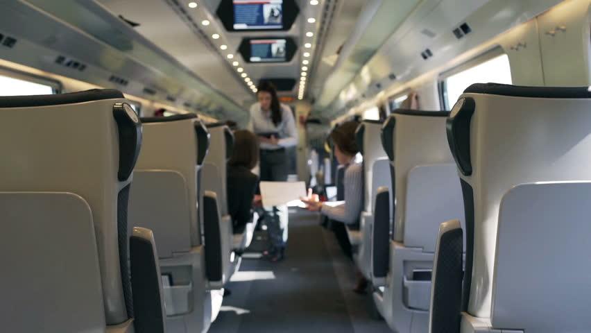 Businesspeople working in the public train, steadycam shot  | Shutterstock HD Video #10468418