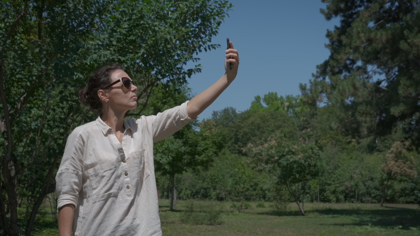 No phone signal. Woman in nature catches an internet signal. | Shutterstock HD Video #1046931148