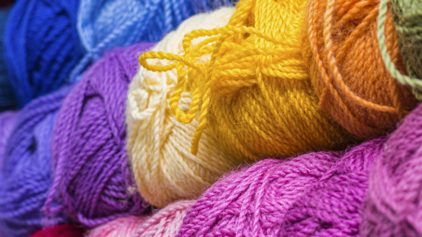 Colorful balls of wool thread for knitting. Closeup. | Shutterstock HD Video #1047087838