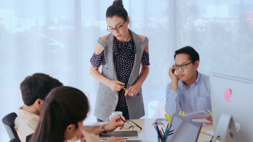 Unhappy business people in group meeting in office. The team is frustrated because of project failure. Business problem and crisis concept. | Shutterstock HD Video #1047189718