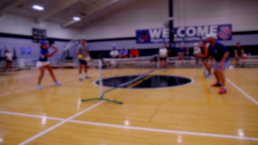 Blur  BACKPLATE OF  PEOPLE PLAYING PICKLEBALL.  | Shutterstock HD Video #1047249298