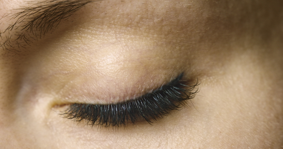 Macro close-up woman's eye. Natural beauty. Slow motion.   Shutterstock HD Video #1047249928
