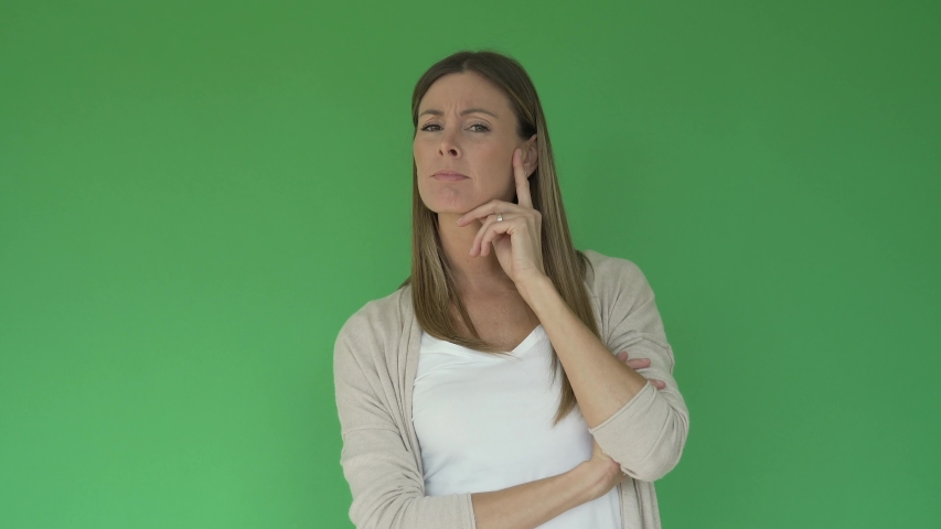 Portrait of cheerful woman showing thumbs up on green background, isolated | Shutterstock HD Video #1047332638