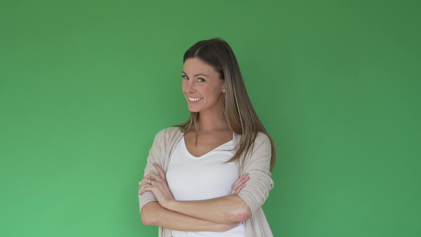 Portrait of beautiful and cheerful woman on green background, isolated | Shutterstock HD Video #1047332728