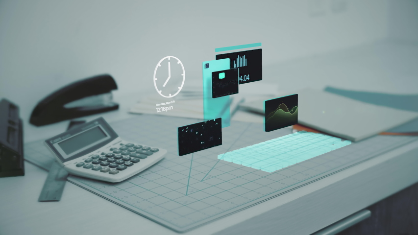 Charts and graphs hover hologram on a financial desk with calculator and office supplies. Futuristic work from home.  | Shutterstock HD Video #1048490158