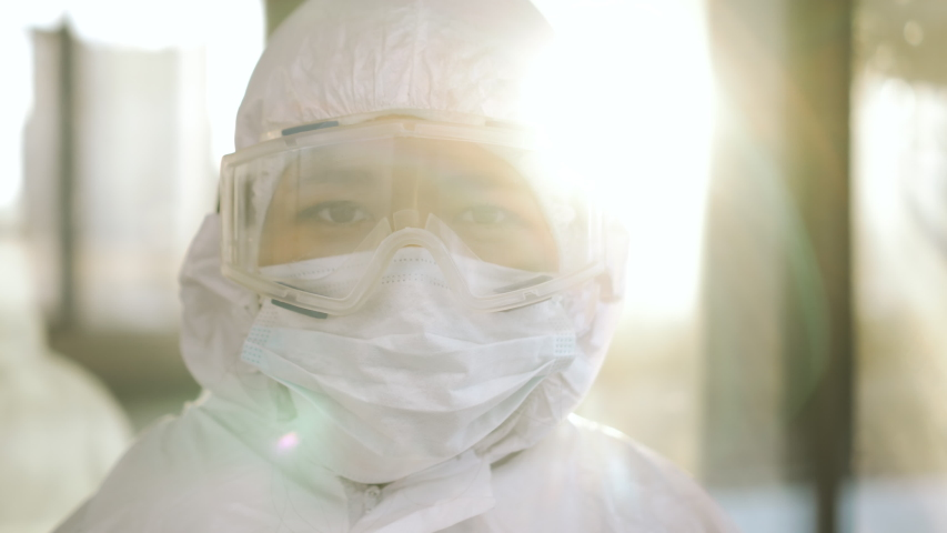 Portrait of epidemiologist protecting patients from coronavirus COVID-19 in mask. Global pandemic epidemic, Europe, Italy, USA. Doctor virologist working in suit, glasses. Appearance from blur | Shutterstock HD Video #1048609798