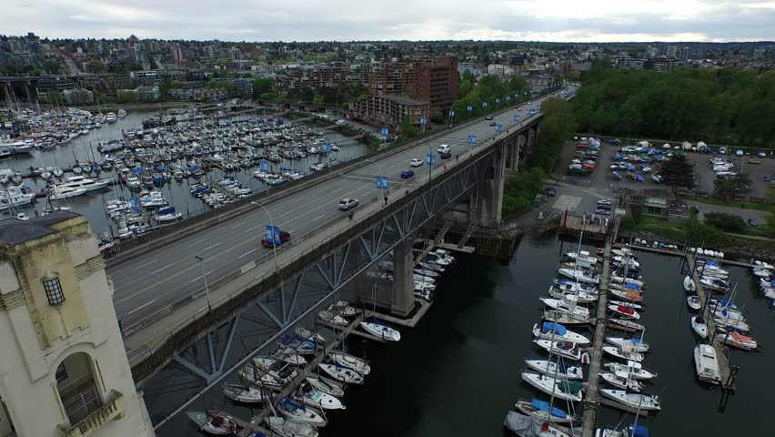 4K Aerial Hovering Shot of Traffic on the Burrard Street Bridge in Vancouver, British Columbia (Aerial Drone Footage captured with the DJI Inspire-1) | Shutterstock HD Video #10487438