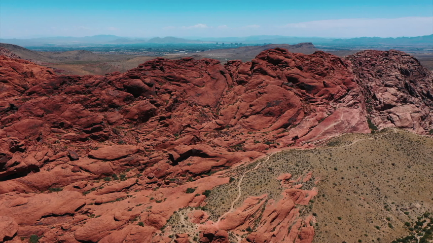 Stunning aerial landscape views of Red Rock Canyon in in Nevada's Mojave Desert near Las Vegas. | Shutterstock HD Video #1049465548