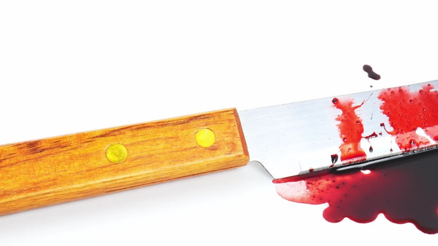 Move the camera angle from left to right, Blood knives are spread over on a white background.   Shutterstock HD Video #1049493568