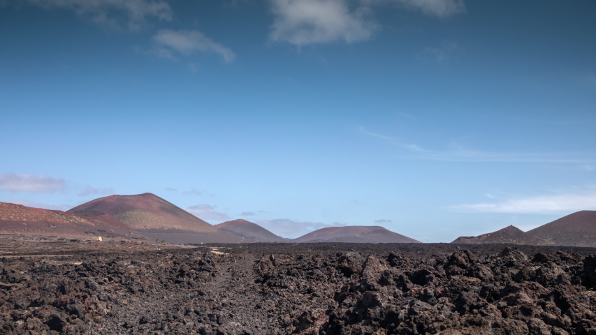 Timelapse of clouds passing over wild arid landscape of the Timanfaya National Park in Lanzarote. | Shutterstock HD Video #1049653348