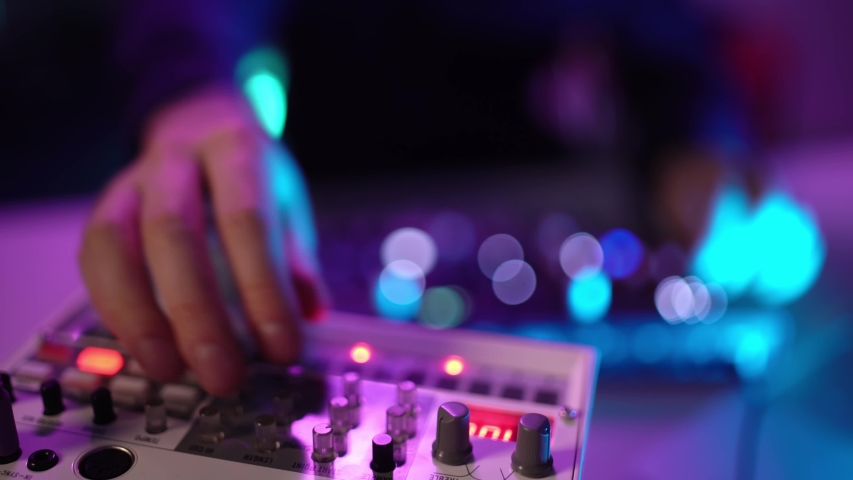 Close up shot of hand's man DJ playing music at home recording studio workshop. Student learns to write creative atmosphere music. Online education training. Sound beat maker. Colorful Neon light | Shutterstock HD Video #1049707978