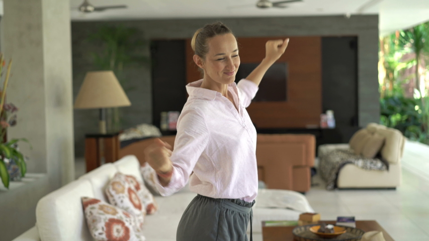 Happy beautiful young woman dancing at luxury home | Shutterstock HD Video #1049732548