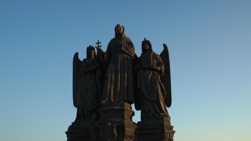 Statues of saint on Charles bridge in Prague. Saint Frantisek Serafinsky. Czech history and culture. | Shutterstock HD Video #1050036778