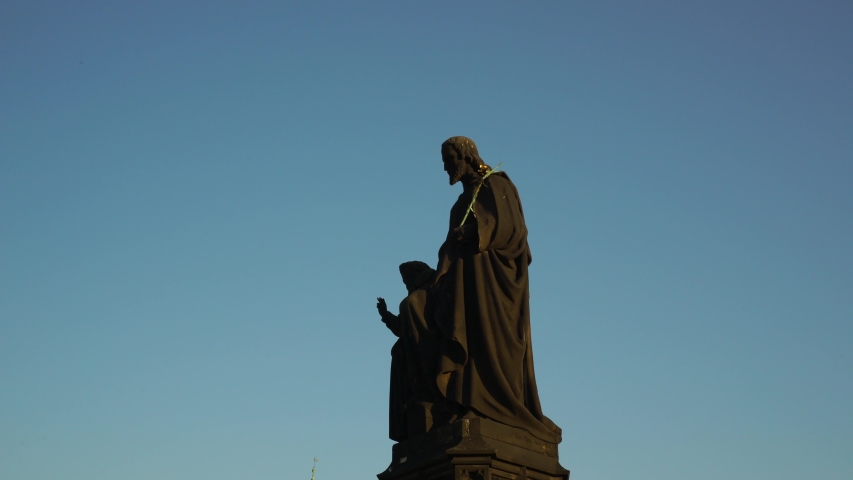 Charles bridge and statues of the saints in Prague. Saint Joseph and Jesus. Czech history and culture. | Shutterstock HD Video #1050036808