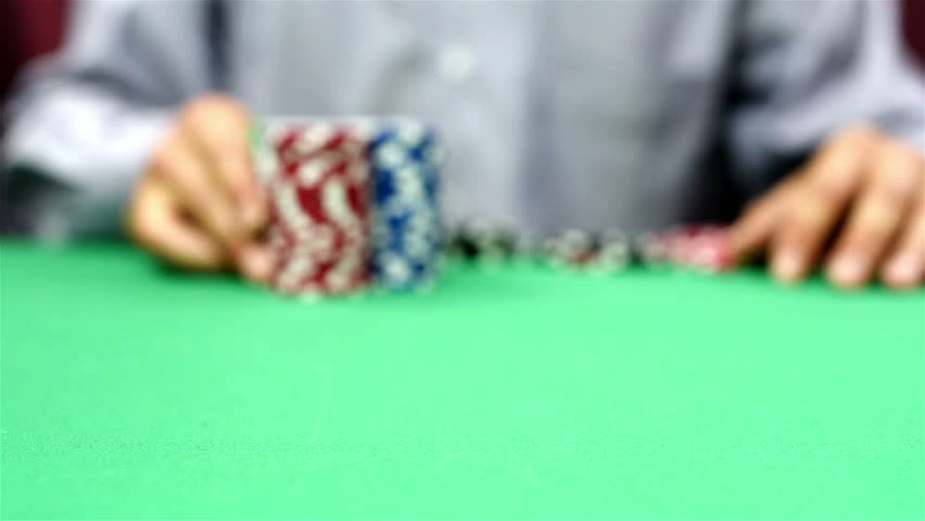 Dealer moves a stack of poker chips, close up | Shutterstock HD Video #10535438