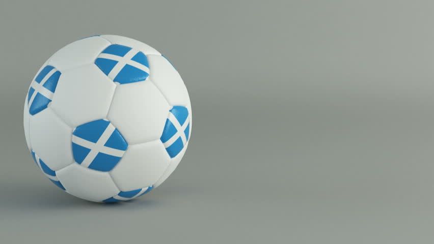 3d football soccer ball containing the flag of scotland spinning on a white background stock