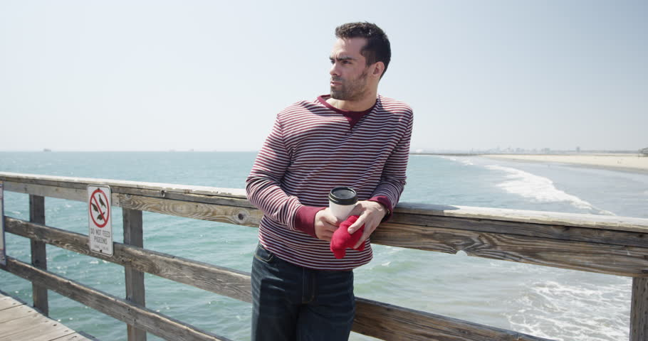 Young caucasian adult man thinking about date on a pier #10564268