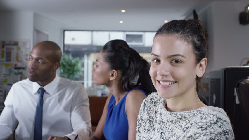 4K Portrait of young professional female in business meeting with colleagues | Shutterstock HD Video #10577576