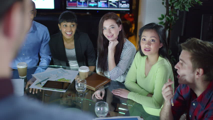4K Happy Attractive Business Group Laughing Together In A Meeting