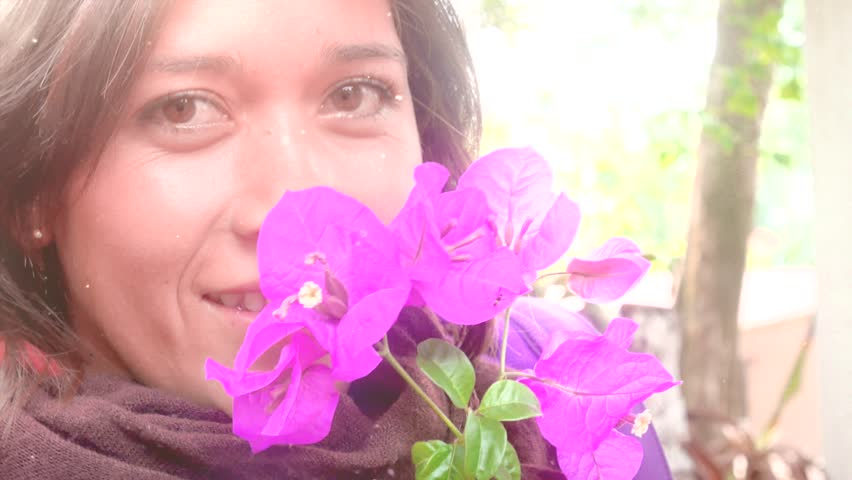 Portrait of young beautiful smiling hispanic woman with pink flowers around her face #10607108