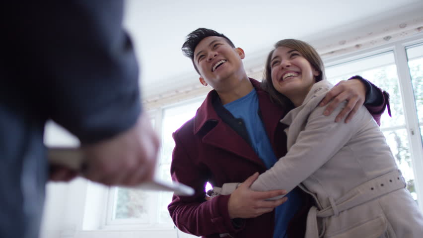 4K Young couple with real estate agent, looking at home to buy or rent | Shutterstock HD Video #10608266