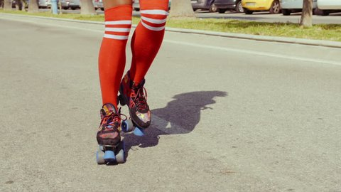 Retro Stylized Sexy Girl Riding Among Palm Trees On Roller Skates. Slow Motion Video