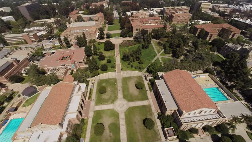 Aerial .Flying over the University of California, Los Angeles, Beverly Hills. The library building, administrative office, royce hall, UCLA International Institute, Hugh and Hazel Darling Law Library