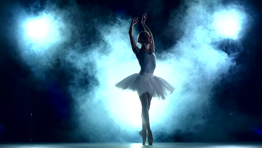 graceful ballerina doing a workout in the classroom. Smoke, fog, silhouette. ballet dancer in white tutu, girl in pointe, whirls around you, slow motion #10617803