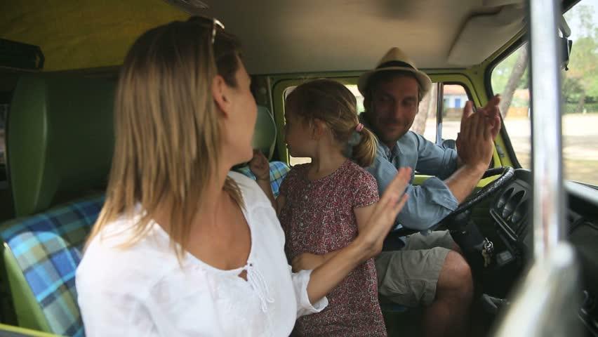 Family having fun singing in camper van   Shutterstock HD Video #10625318