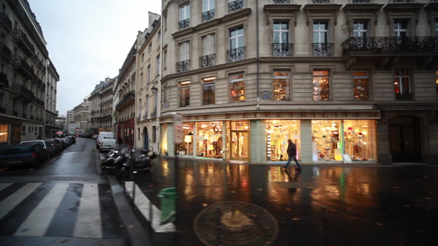 streets and homes with showcases in heart of Paris, view from passing bus window