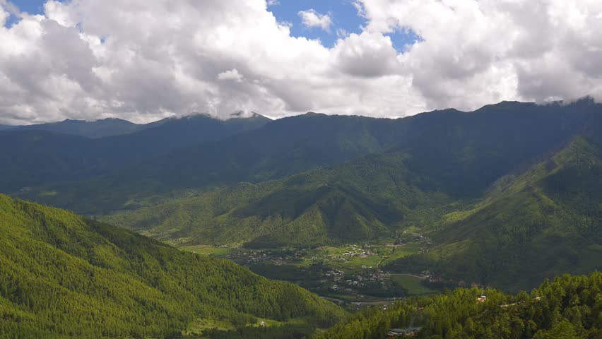 Paro valley with cloudy ,Bhutan. Paro is the location of  only one international airport in Bhutan. During moving cloud you can see  airplane prepare to landing.