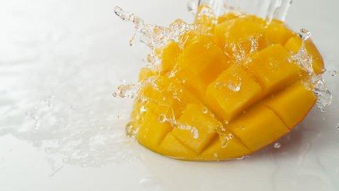 Water splash and mango. Shot with high speed camera, phantom flex 4K. Slow Motion.