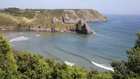 View of Three Cliffs Bay the Gower Peninsula Swansea Wales uk from the west