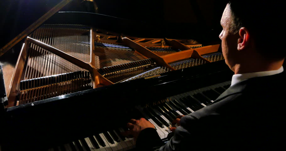 4K Professional Pianist Plays Grand Piano, Strings and Hammers Lit with Cinematographic Film-style Lighting