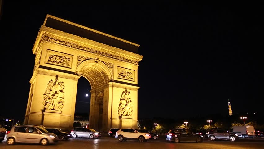 PARIS - JUNE 2, 2015: Nighttime timelapse with the Arc de Triomphe as traffic passes by | Shutterstock HD Video #10751915