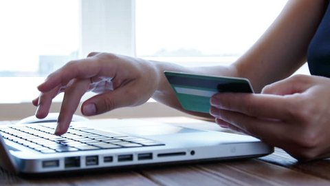 Paying with a credit card online, shopping