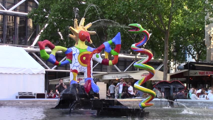 PARIS, FRANCE - JUNE 6, 2015: Stravinsky Fountain (1983) is a fountain with 16 works of sculpture, moving and spraying water, representing works of composer Igor Stravinsky. Place Stravinsky, Paris.