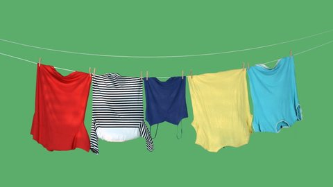 Drying laundry in the wind on green screen.
