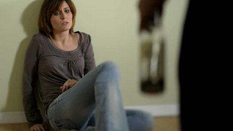 Woman scared of man; abuse/domestic violence; HD Photo JPEG