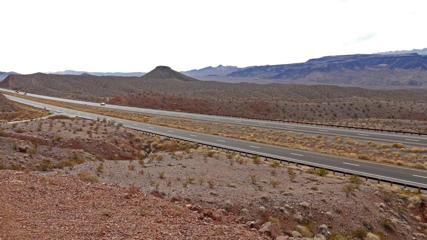 Ultra Wide view of 18-wheeler semi truck on open desert highway. 4K UHD footage.