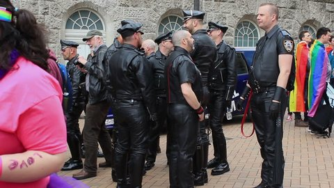 Fetishism - group of men wearing black, leather clothes on Victoria Square -  Birmingham Gay Pride, England 2015