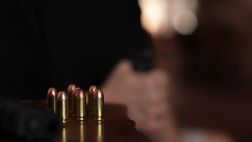 Loading a handgun magazine