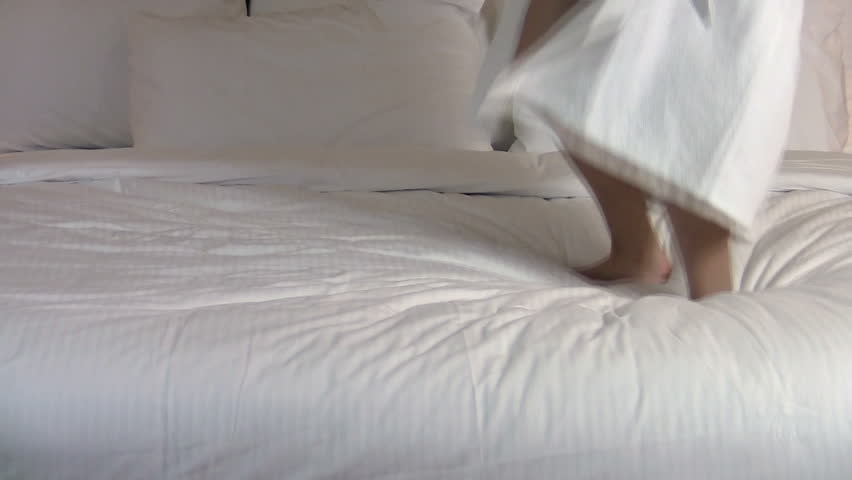 Excited girl jumps on bed - HD