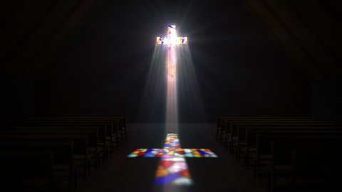 Dark church. Light comes through the cross with colored stained glass on the wall