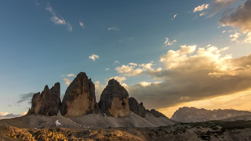 time lapse of dolomites peaks tre cime di lavaredo from day to night clouds moving over the mountains
