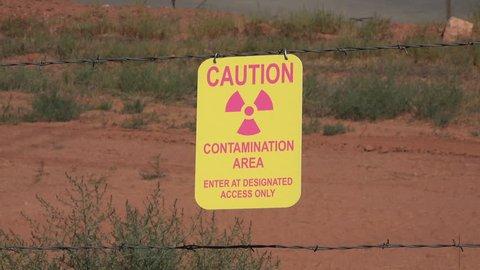 MOAB, UTAH - JUL 2015: Moab Utah UMTRA radiation uranium contamination caution 4K. Uranium mill waste situated alongside Colorado River. US Department of Energy. Cleanup cost $720 million.